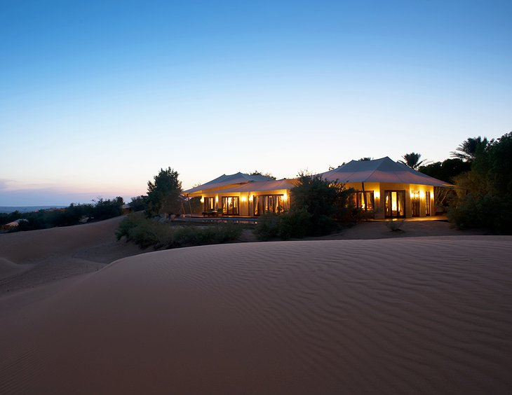 Al Maha Desert Resort tent at night