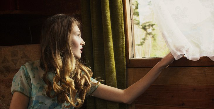 Beautiful girl looking out of the train window
