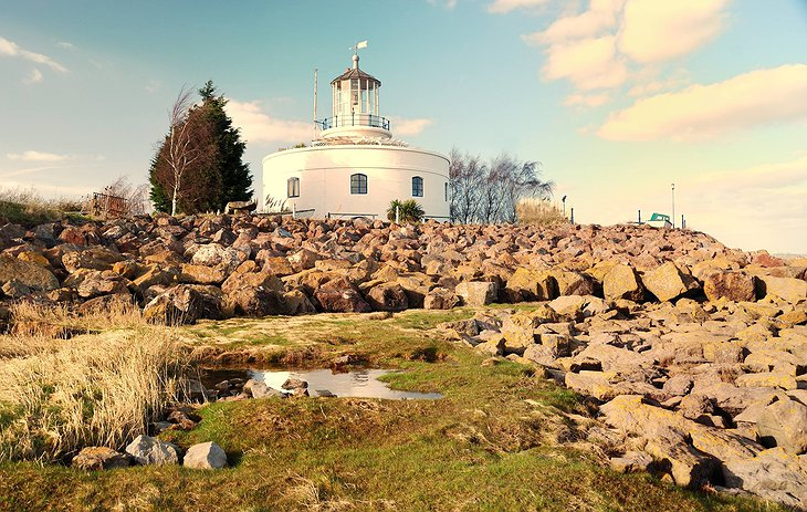 West Usk Lighthouse and the rocky beach