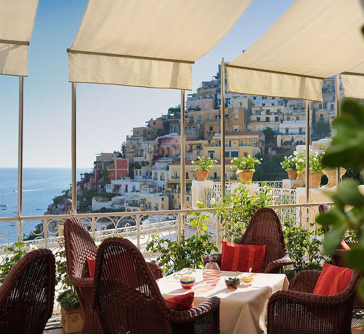 Dining on the terrace of Le Sirenuse Hotel with view on Positano