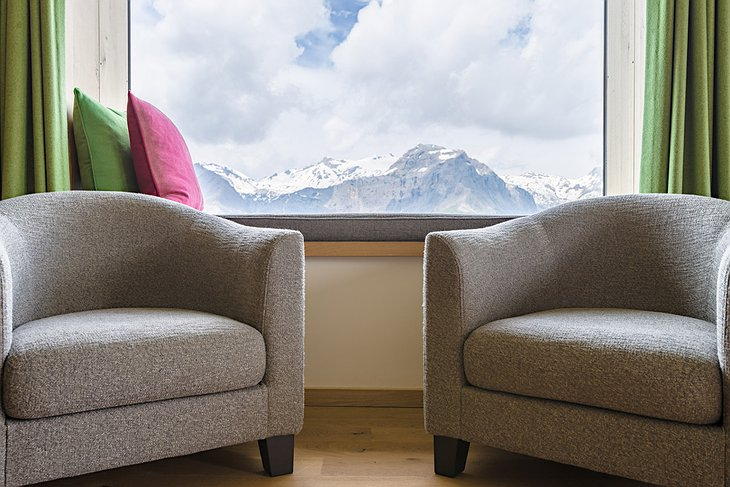 Hotel Chetzeron chairs with mountain background