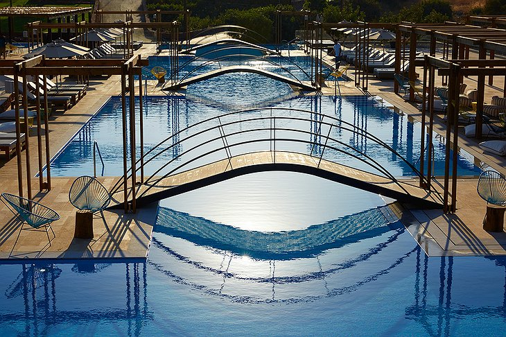 Domes of Elounda outdoor pools with bridges above them