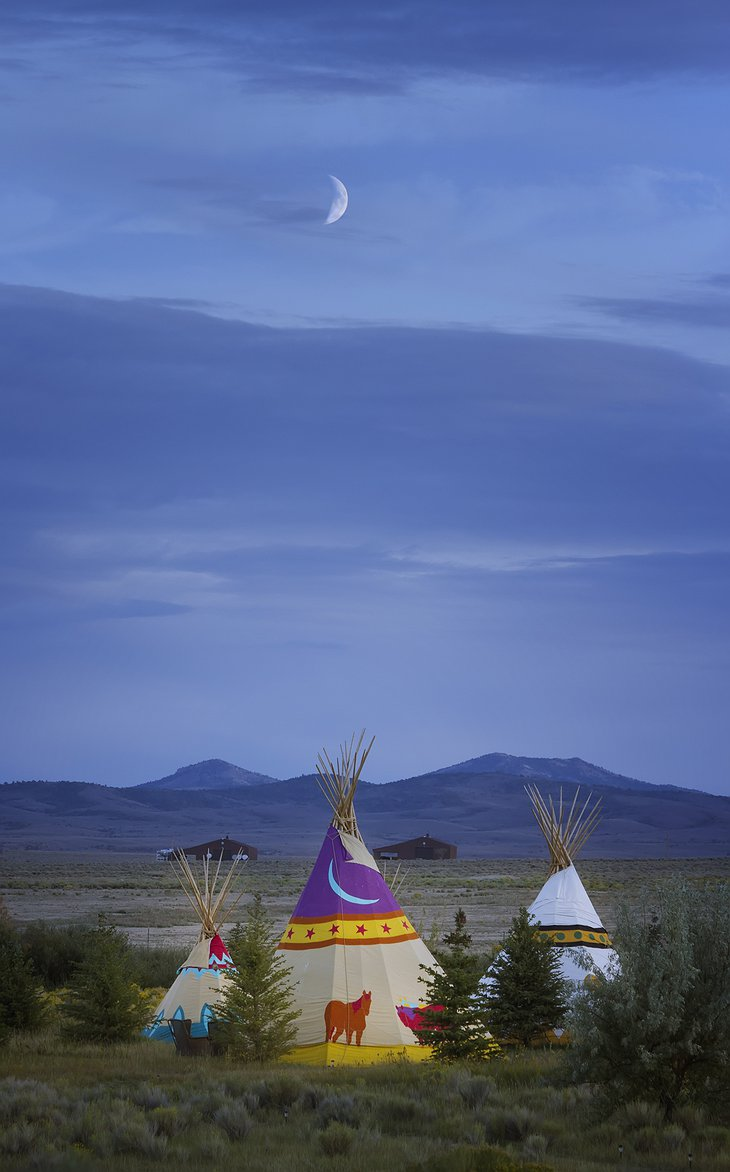 Mustang Monument Resort tipis at night