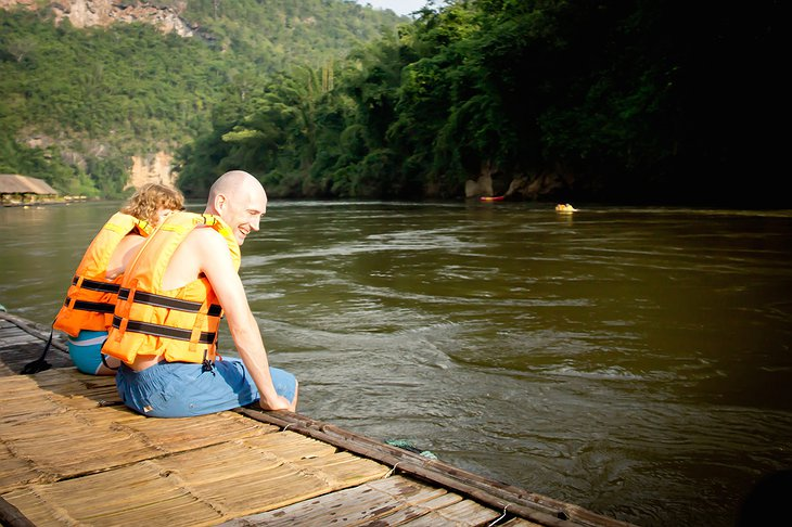 Sitting on the wooden platform at the River Kwai