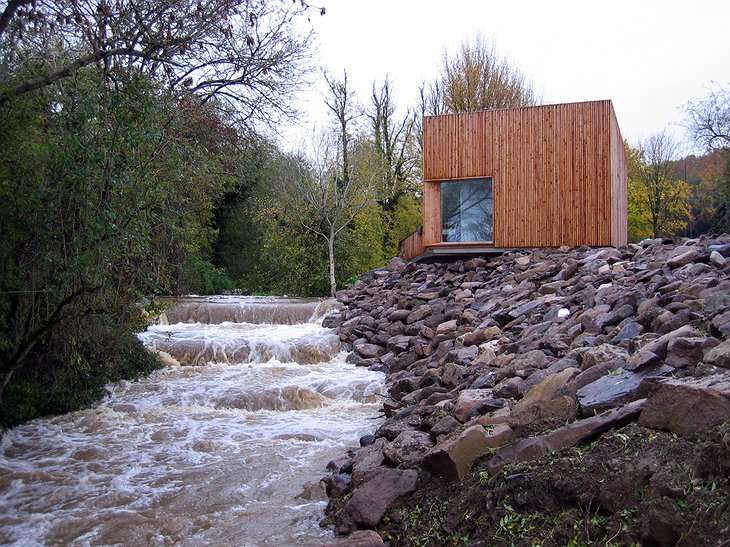Glencomeragh Hermitages wooden hut next to the river