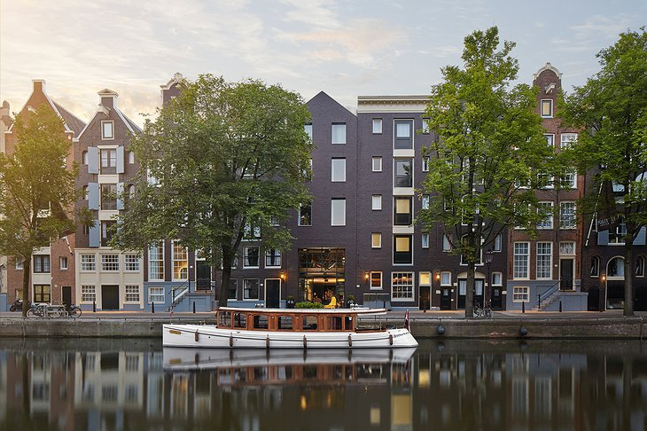 Pulitzer Amsterdam exterior with canal and a boat