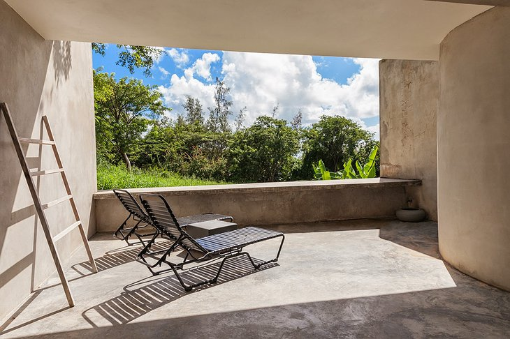 Triangular house concrete balcony with jungle view