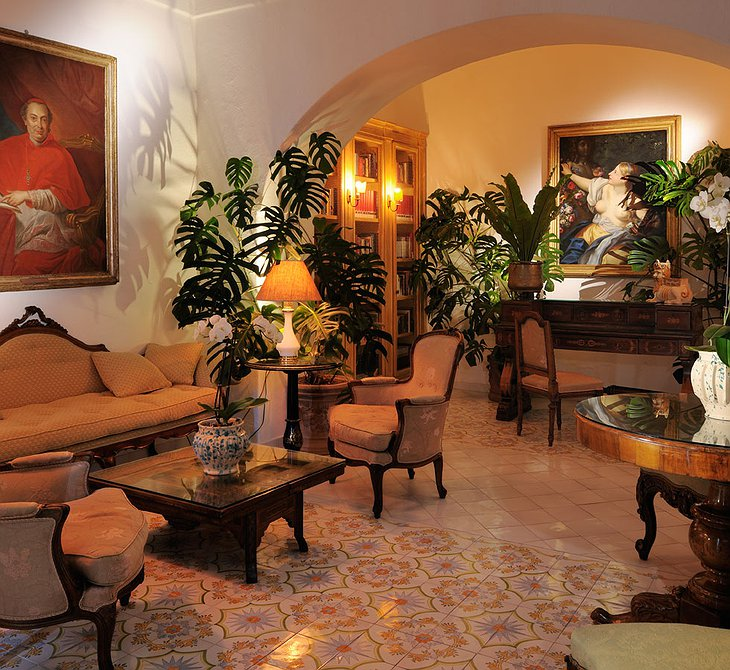 Le Sirenuse Hotel interior with vintage paintings on the wall