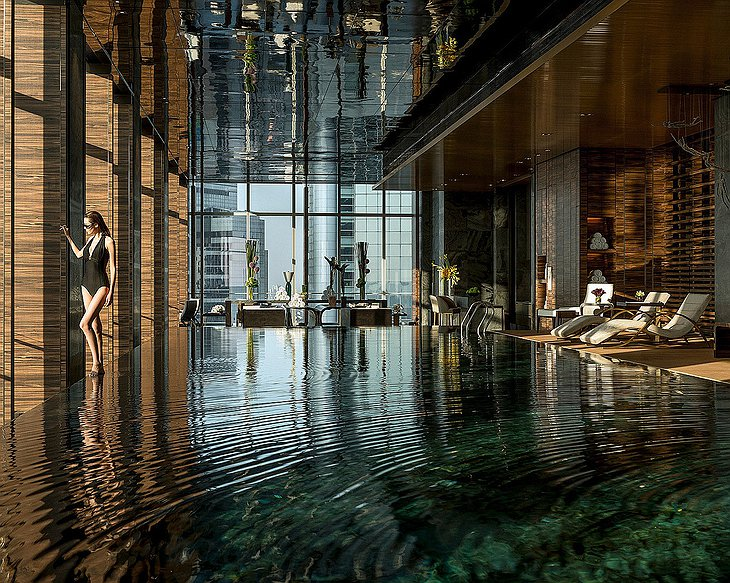 Four Seasons Hotel Pudong swimming pool with a girl in black swimsuit