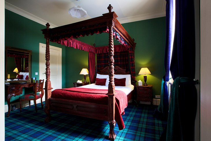 Tulloch Castle Hotel room with four-poster bed