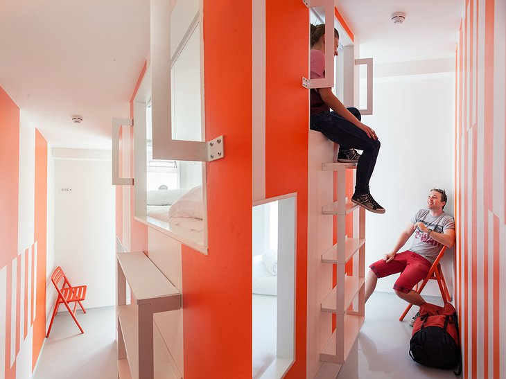 Boutique Hostel Forum orange and white chat room with people talking