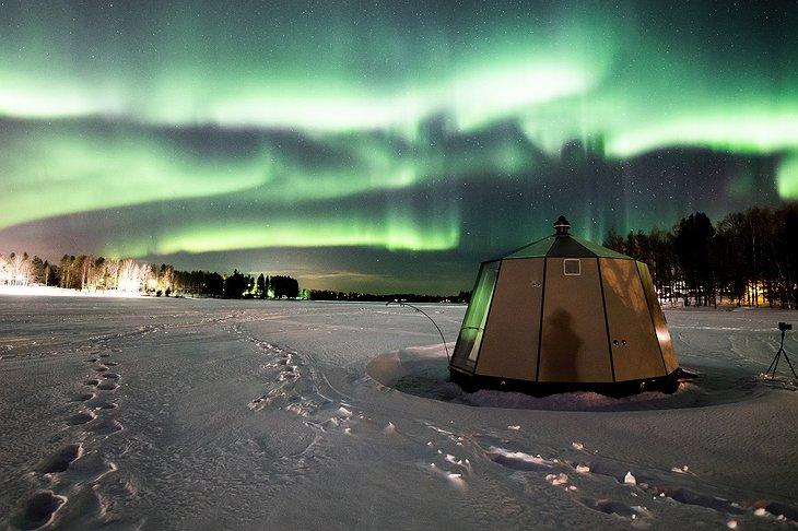 Northern lights at lake Ranua during winter