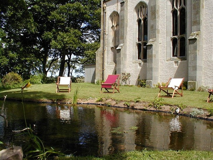 The Old Church of Urquhart garden with a pond