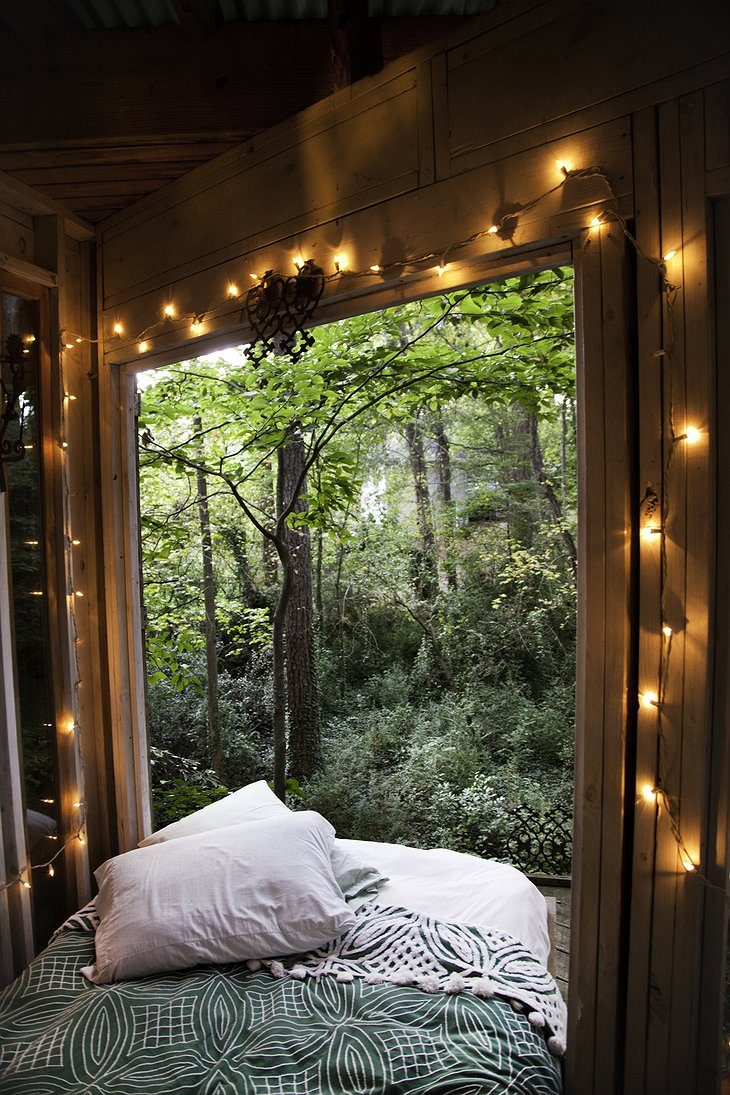 Secluded Intown Treehouse bedroom with open windows to nature