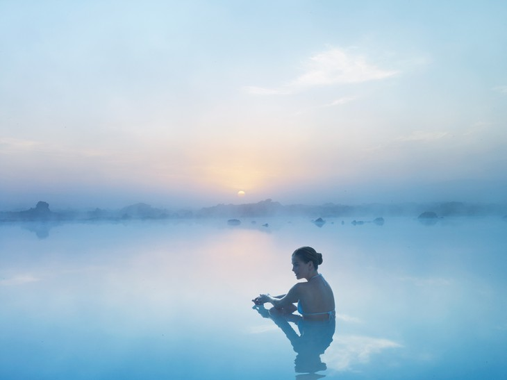 Beautiful woman enjoying the Blue Lagoon in Iceland