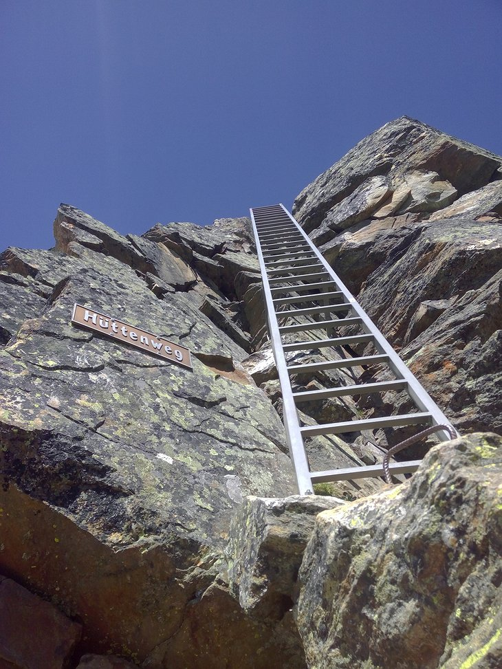 Ladder on the rocks to climb up to the Mischabel Hut