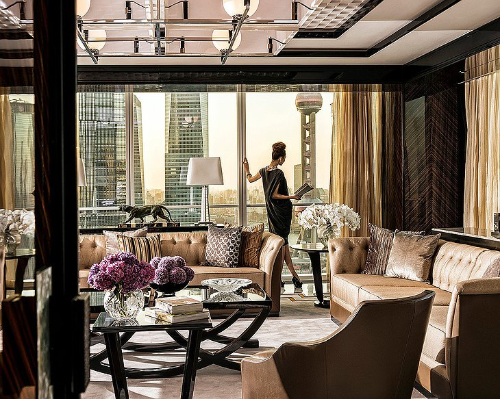 Four Seasons Hotel Pudong pearl suite with a classy woman looking at the city skyline