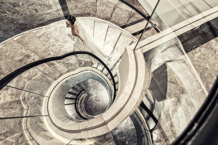 Four Seasons Hotel Pudong circle staircase with a woman in wedding dress