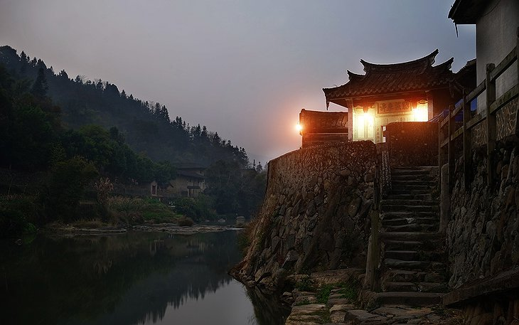 Tulou Fuyulou Changdi Inn at the River at Night