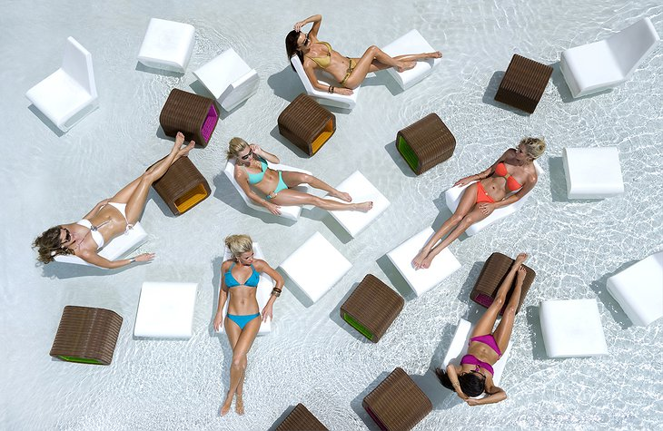 Women in bikini at the pool from above