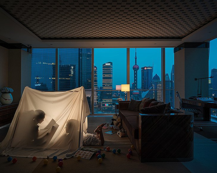 Four Seasons Hotel Pudong room at night with kids playing