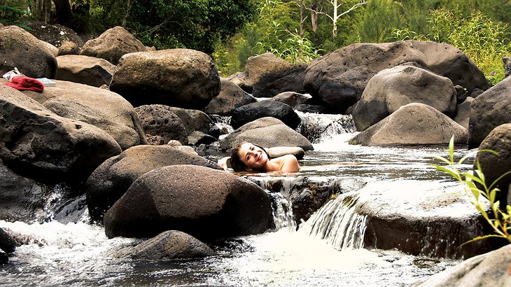 Girl bathing naked in the rapids
