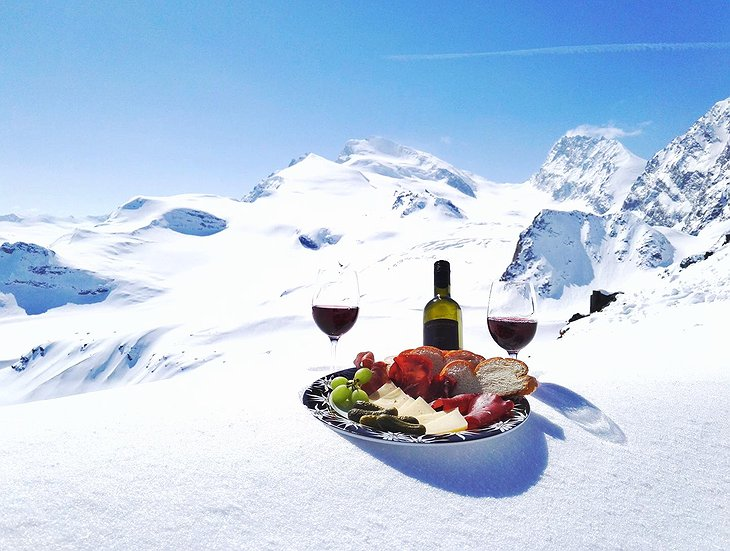 Wine Swiss appetizers in the snowy Alps