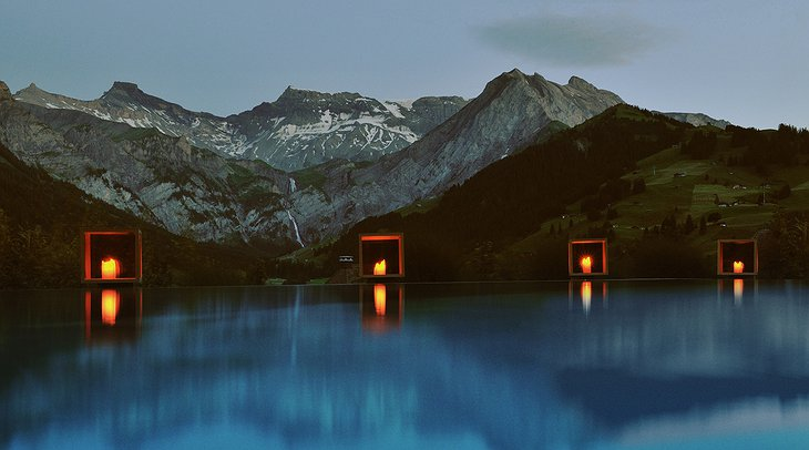 The Cambrian outdoor swimming pool at night with lights and view on the mountains