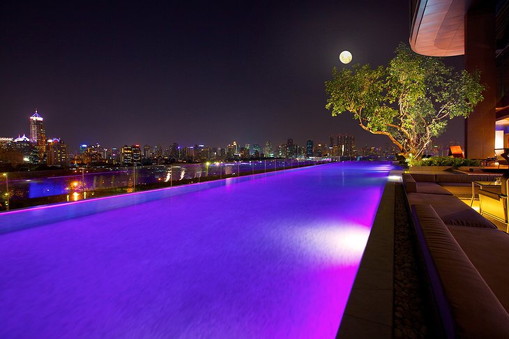 Infinity Pool at night with purple lights