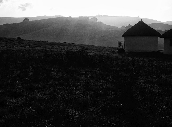 Bulungula Lodge huts in black and white