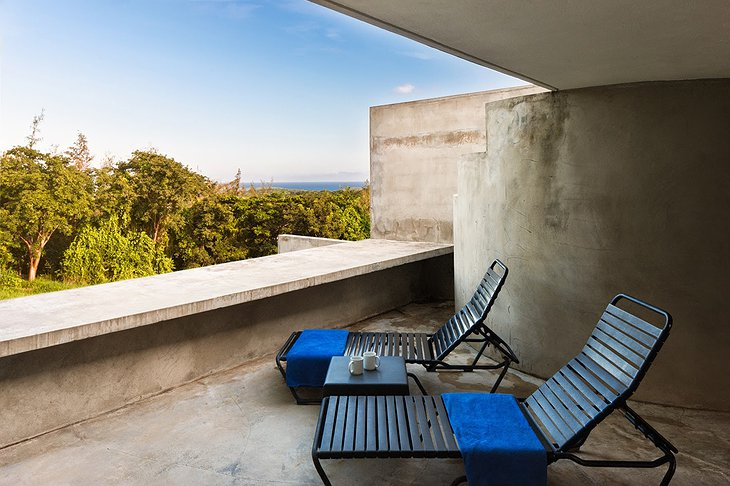 Triangular house concrete terrace with sea view
