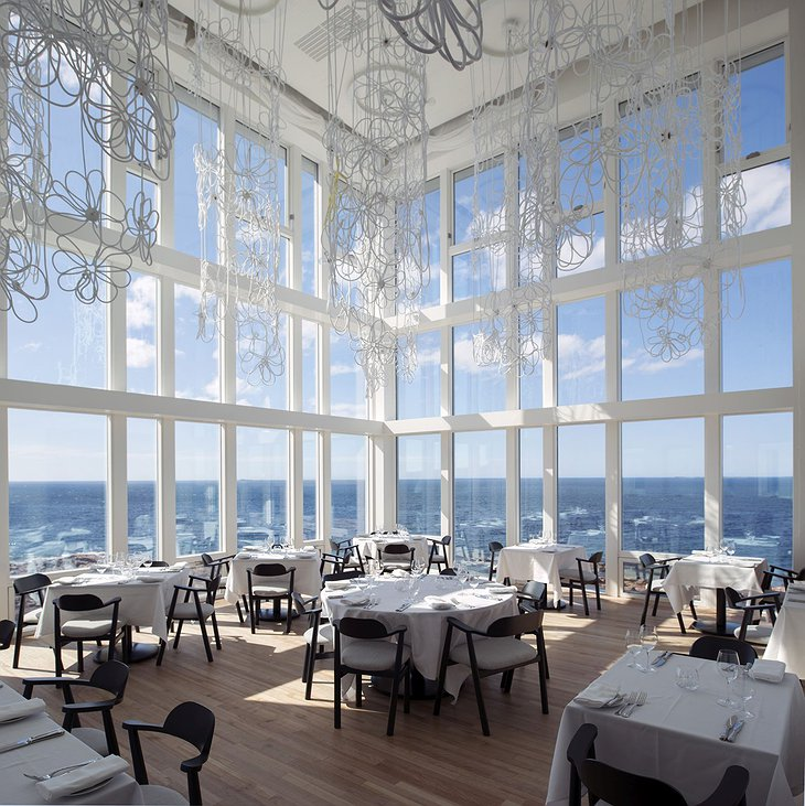 Fogo Island Inn restaurant with floor to ceiling windows overlooking the Northern Atlantic sea