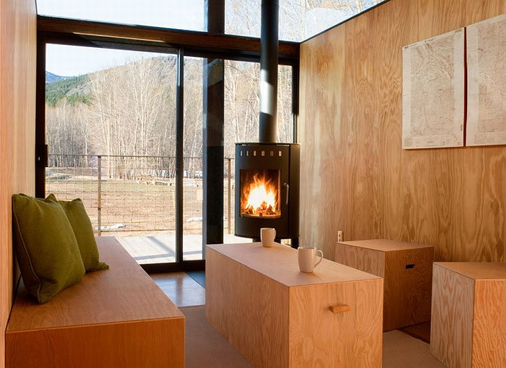 Rolling Huts wooden interior with fireplace