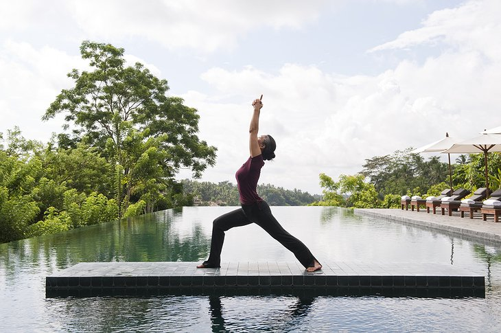Yoga at the swimming pool of Alila Ubud