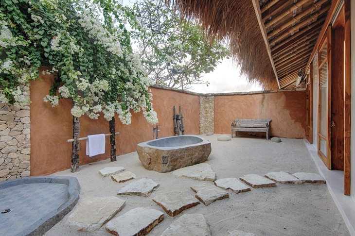 Outdoor bathroom with open air bathtub and shower