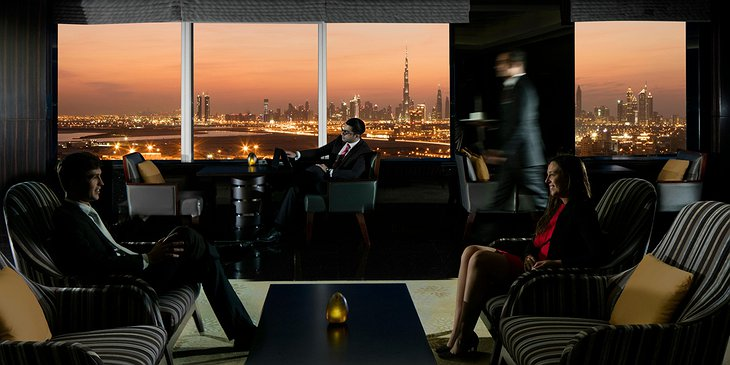 InterContinental Dubai Festival City bar at the evening with business people