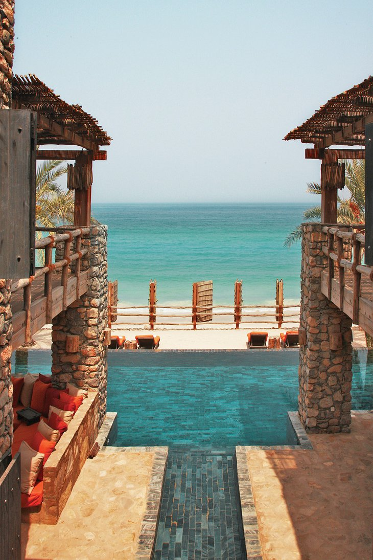 Six Senses Zighy Bay hotel view between the buildings to the swimming pool and the sea