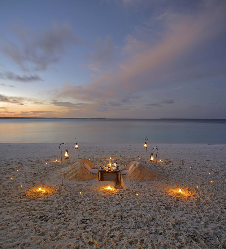 andBeyond Mnemba Island romantic dinner at the beach