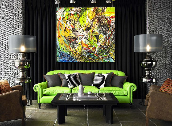 Salthouse Harbour Hotel lounge with green sofa and modern art painting on the wall