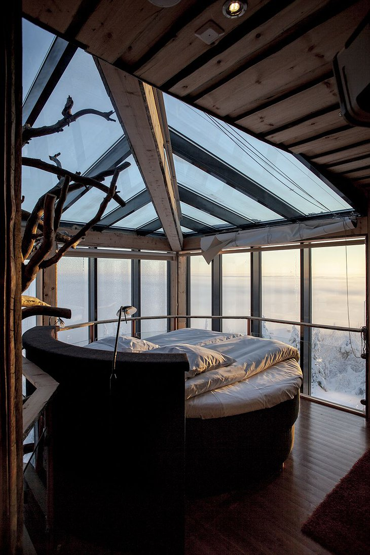 Rounded bed with snowy scenery outside
