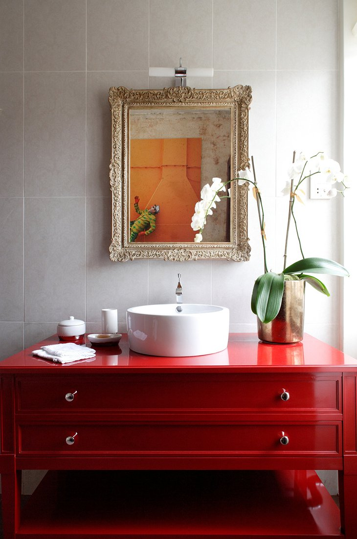 Rough Luxe Hotel red bathroom furniture