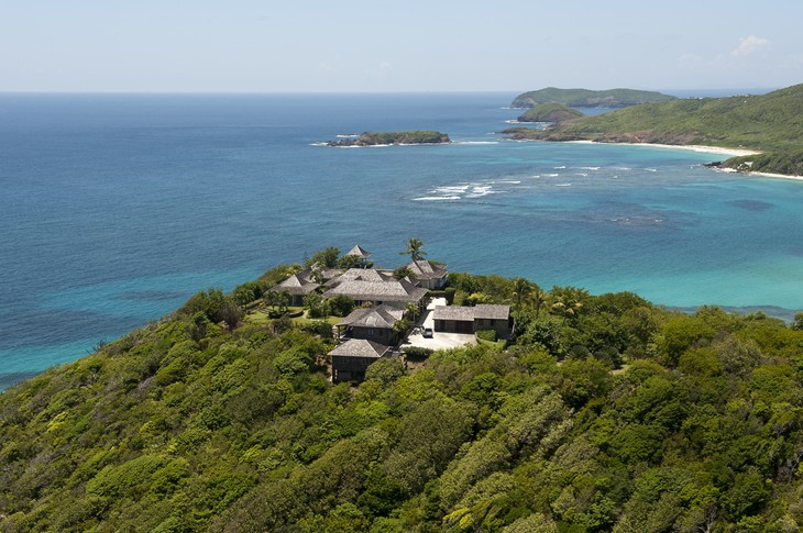Mustique Island with villas on the top of the hill