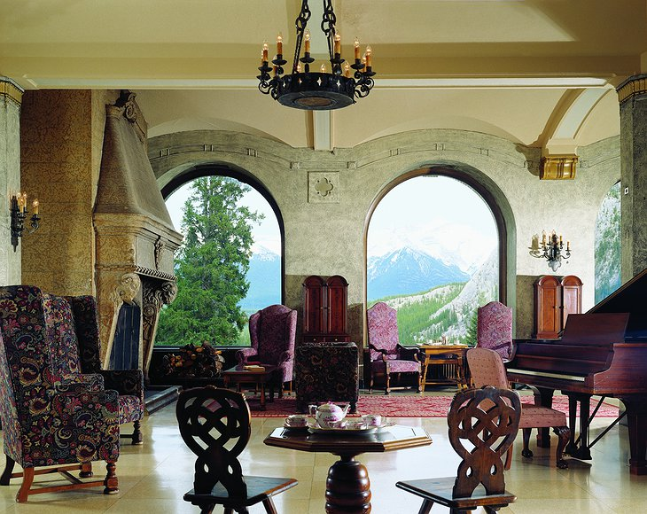 Fairmont Banff Springs Hotel room with piano and view to mountains