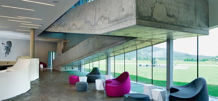 Miura Hotel interior with concrete staircase and colorful furniture
