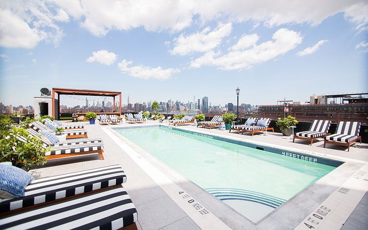 The Williamsburg Hotel rooftop pool with Manhattan panorama