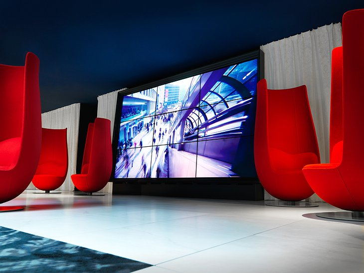 Andaz Amsterdam hotel lobby design chairs and large screen