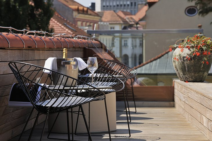 Vander Urbani Resort rooftop chairs and champagne