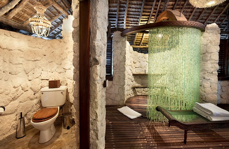 andBeyond Mnemba Island bathroom with toilet and shower