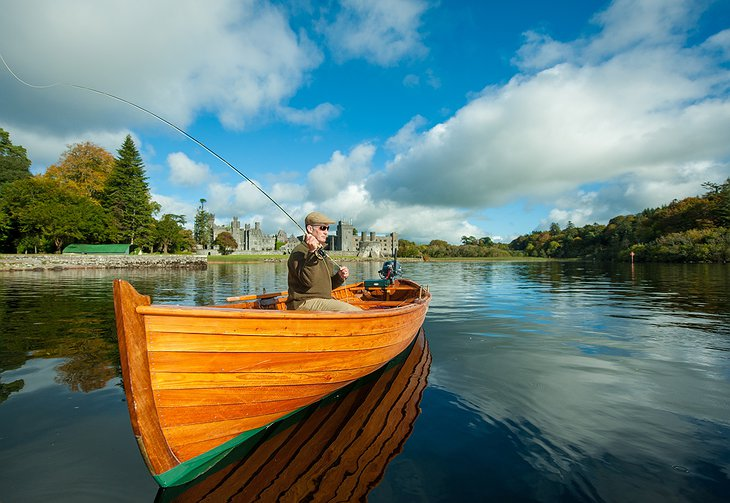 Fishing on the lake with Ashford Castle in the background
