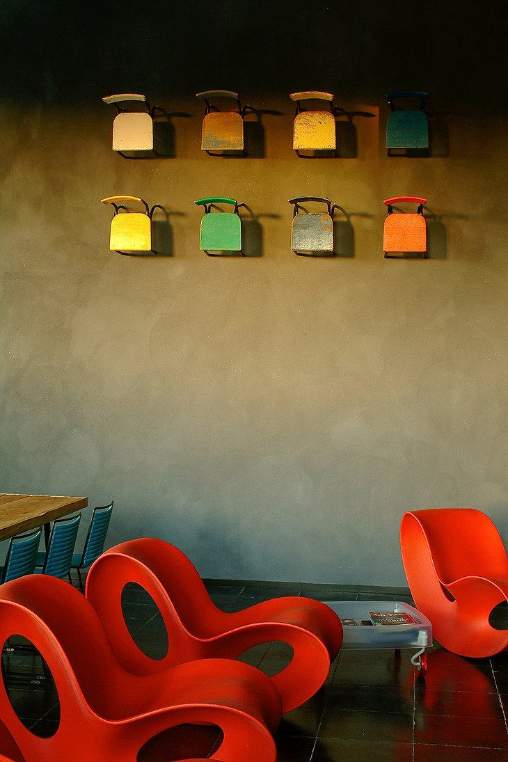 La Classe design chairs and colorful chairs on the wall